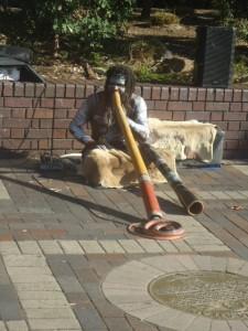 Indigenous Australian playing the didgeridoo
