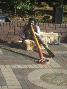 Indigenous Australian playing the didgeridoo